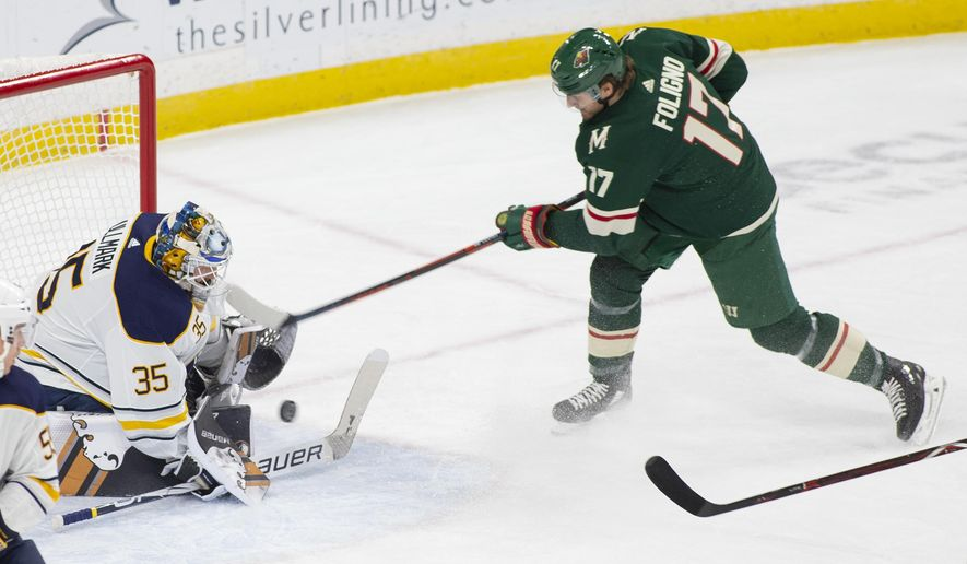 Buffalo Sabres goaltender Linus Ullmark, of Sweden, (35) stops a shot by Minnesota Wild left wing Marcus Foligno (17) during the first period of an NHL hockey Saturday, Nov. 17, 2018, in St. Paul, Minn. (AP Photo/Paul Battaglia)