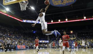 UCLA guard Jaylen Hands goes up for a dunk against Saint Francis during the second half of an NCAA college basketball game Friday, Nov. 16, 2018, in Los Angeles. (AP Photo/Marcio Jose Sanchez)