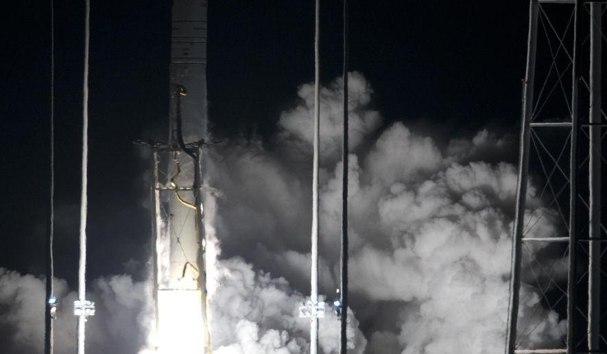 Northrop Grumman Antares rocket lifts off from the launch pad at NASA's Wallops Flight Facility in Wallops Island, Va., Saturday, Nov. 17, 2018. The rocket will deliver supplies to the International Space Station. (AP Photo/Steve Helber)
