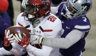 Texas Tech defensive back Adrian Frye (20) intercepts a pass intended for Kansas State wide receiver Isaiah Zuber (7) during the second half of an NCAA college football game in Manhattan, Kan., Saturday, Nov. 17, 2018. (AP Photo/Orlin Wagner)