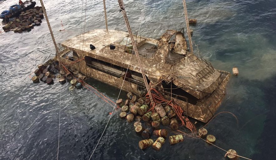 In this photo taken and released by the Thailand Phuket Public Affairs Office, Saturday, Nov. 17, 2018, the tour boat named the Pheonix is raised from the sea floor after sinking over four months ago in rough weather killing 47 tourists. The tour boat was one of two boats that sank off the popular tourist island in stormy weather on July 5, 2018. (Phuket Public Affairs Office via AP)