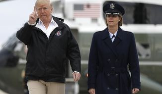 President Donald Trump boards Air Force One for a trip to visit areas impacted by the California wildfires, Saturday, Nov. 17, 2018, at Andrews Air Force Base, Md. (AP Photo/Evan Vucci)