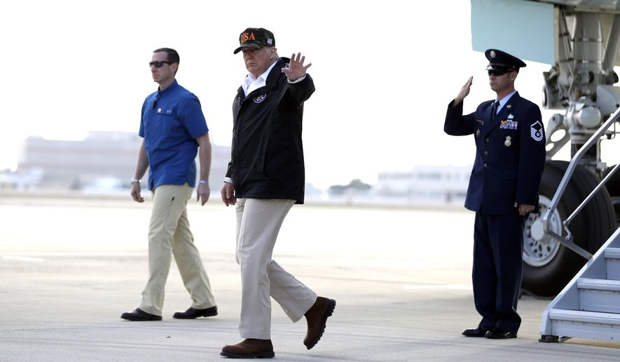 President Donald Trump arrives at Naval Air Station Point Mugu. Calif., for a visit to areas impacted by the wildfires in Malibu, Saturday, Nov. 17, 2018. (AP Photo/Evan Vucci)