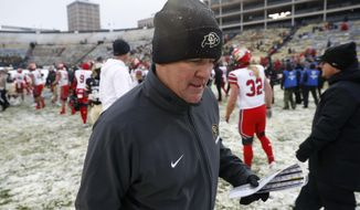 Colorado head coach Mike MacIntyre heads off the field after the second half of an NCAA college football game Saturday, Nov. 17, 2018, in Boulder, Colo. Utah won 30-7. (AP Photo/David Zalubowski)