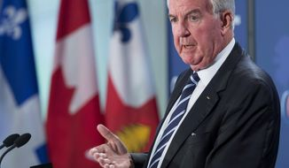 """FILE - In this May 18, 2018, file photo, Craig Reedie, head of the World Anti-Doping Agency, speaks to the Montreal Council on Foreign Relations in Montreal. At the same time WADA announced changes to its governance structure, the agency's former lead investigator, Jack Robertson, wrote an op-ed piece arguing its leaders should be replaced, and said the decision to reinstate Russia's suspended anti-doping agency came via a ``cowardly'' process that betrayed clean athletes. WADA, in a statement to the BBC, dismissed Robertson's analysis as """"old and baseless allegations"""" that are part of a politically motivated campaign against the agency and Reedie. (Ryan Remiorz/The Canadian Press via AP, File)"""