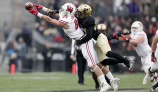 Purdue safety Navon Mosley (27) breaks up a pass to Wisconsin tight end Jake Ferguson (84) during the first half of an NCAA college football game in West Lafayette, Ind., Saturday, Nov. 17, 2018. (AP Photo/Michael Conroy)