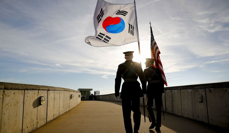 Members of the Honor Guard carry U.S. and South Korea flags after participating in the 2018 Security Consultative at the Pentagon, co-hosted by Defense Secretary Jim Mattis and South Korea Minister of Defense Jeong Kyeong-doo, Wednesday, Oct. 31, 2018. (AP Photo/Pablo Martinez Monsivais)