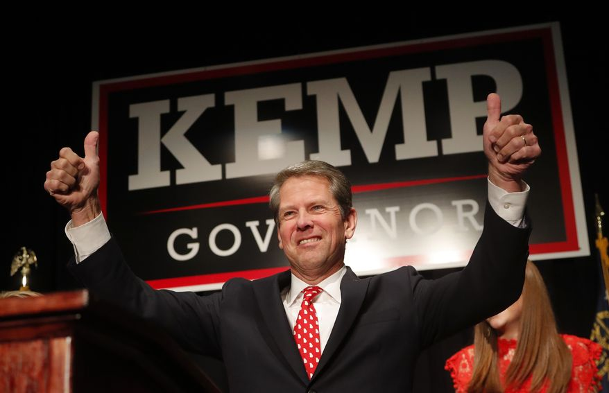 Georgia Republican gubernatorial candidate Brian Kemp gives a thumbs-up to supporters, Wednesday, Nov. 7, 2018, in Athens, Ga. (AP Photo/John Bazemore)