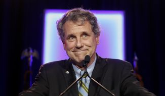 In this Nov. 6, 2018 file photo, Sen. Sherrod Brown, D-Ohio, reacts as he speaks to the audience during the Ohio Democratic Party election night watch party in Columbus, Ohio. (AP Photo/John Minchillo, File)