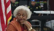 Broward County Supervisor of Elections Brenda Snipes listens to reports Sunday, Nov. 18, 2018, at the Broward Supervisor of Elections office in Lauderhill, Fla. Broward County reported their recount results with 52 minutes to spare Sunday. (Joe Cavaretta/South Florida Sun-Sentinel via AP)