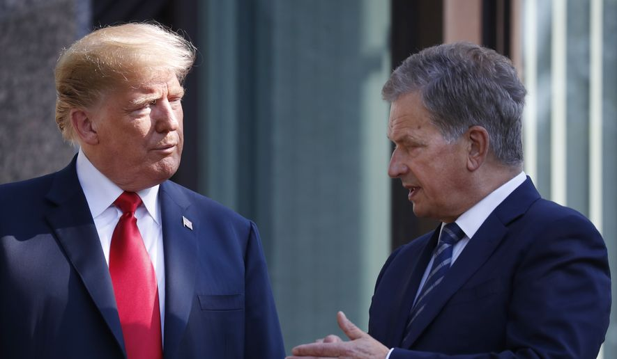 In this July 16, 2018 file photo, U.S. President Donald Trump, left, talks with Finnish President Sauli Niinisto as they pose for a photo in Helsinki, Finland. Niinisto said in an interview published on Sunday, Nov. 18, 2018, that he briefed Trump in the wake of the California wildfires on how the Nordic country effectively monitors its substantial forest resources with a well-working surveillance system. (AP Photo/Pablo Martinez Monsivais, File)