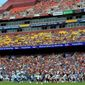 FILE - In this Sept. 16, 2018, file photo, spectators watch the first half of an NFL football game between the Washington Redskins and the Indianapolis Colts at FedEx Field in Landover, Md. Washington is 3-2 at home this season and leads the NFC East. But after cornerback Josh Norman called out Redskins fans in the aftermath of an ugly victory at Tampa Bay, the spotlight is on the atmosphere at FedEx Field Sunday against the AFC South-leading Houston Texans.  (AP Photo/Mark Tenally, File)
