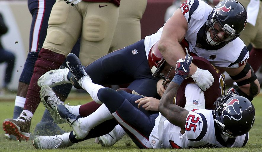 Houston Texans defensive end J.J. Watt (99) and Houston Texans strong safety Kareem Jackson (25) take down Washington Redskins quarterback Alex Smith (11) for a sack against the Washington Redskins in an NFL game, Sunday, November 18, 2018 in Landover, Md. (AP Photo/Daniel Kucin Jr.)