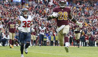 Washington Redskins running back Adrian Peterson (26) carries the ball toward the end zone for a touchdown during the second half of an NFL football game against the Houston Texans, Sunday, Nov. 18, 2018 in Landover, Md. (AP Photo/Alex Brandon)