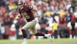 Washington Redskins quarterback Colt McCoy (12) scrambles with the ball during the second half of an NFL football game between the Houston Texans and the Washington Redskins, Sunday, Nov. 18, 2018 in Landover, Md. (AP Photo/Pablo Martinez Monsivais)