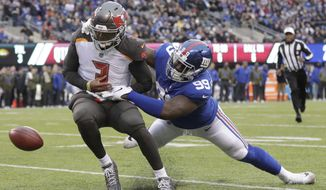 New York Giants' Mario Edwards, right, forces Tampa Bay Buccaneers quarterback Jameis Winston to fumble near the goal line during the second half of an NFL football game, Sunday, Nov. 18, 2018, in East Rutherford, N.J. (AP Photo/Julio Cortez)