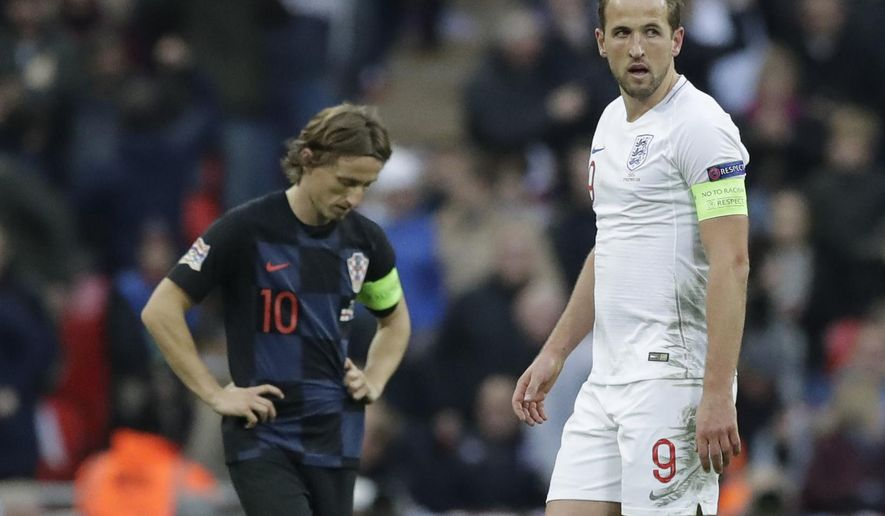 England's Harry Kane walks next to Croatia's Luka Modric, left, after scoring his side's second goal during the UEFA Nations League soccer match between England and Croatia at Wembley stadium in London, Sunday, Nov. 18, 2018. (AP Photo/Matt Dunham)