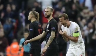 England's Harry Kane celebrates scoring his side's second goal during the UEFA Nations League soccer match between England and Croatia at Wembley stadium in London, Sunday, Nov. 18, 2018. (AP Photo/Matt Dunham)