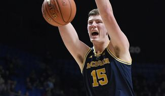 Michigan's Jon Teske (15) dunks during the second half of an NCAA college basketball game against Providence, Sunday, Nov. 18, 2018, in Uncasville, Conn. (AP Photo/Jessica Hill)