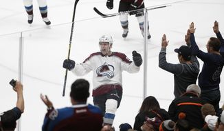 Colorado Avalanche's Mikko Rantanen, center, of Finland, celebrates his overtime goal in an NHL hockey game against the Anaheim Ducks on Sunday, Nov. 18, 2018, in Anaheim, Calif. The Avalanche won 4-3. (AP Photo/Jae C. Hong)