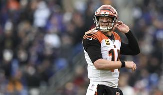 Cincinnati Bengals quarterback Andy Dalton walks off the field after not being able to convert for a first down in the second half of an NFL football game against the Baltimore Ravens, Sunday, Nov. 18, 2018, in Baltimore. Baltimore won 24-21. (AP Photo/Gail Burton)