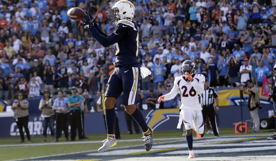 Los Angeles Chargers wide receiver Keenan Allen catches a touchdown pass against the Denver Broncos during the first half of an NFL football game Sunday, Nov. 18, 2018, in Carson, Calif. (AP Photo/Marcio Jose Sanchez)