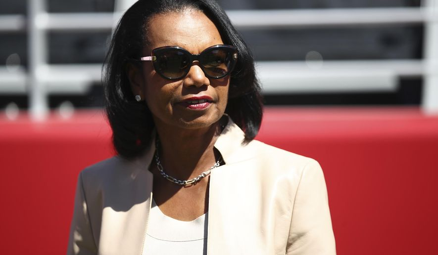 In this Sept. 16, 2018, file photo former Secretary of State Condoleezza Rice stands on the sidelines before the start of an NFL football game between the San Francisco 49ers and the Detroit Lions in Santa Clara, Calif. (AP Photo/Ben Margot, File)