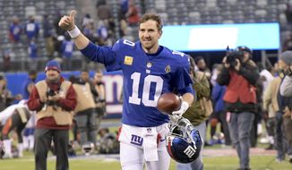 New York Giants quarterback Eli Manning gives a thumbs up to the crowd after an NFL football game against the Tampa Bay Buccaneers, Sunday, Nov. 18, 2018, in East Rutherford, N.J. The Giants defeated the Buccaneers 38-35. (AP Photo/Bill Kostroun)