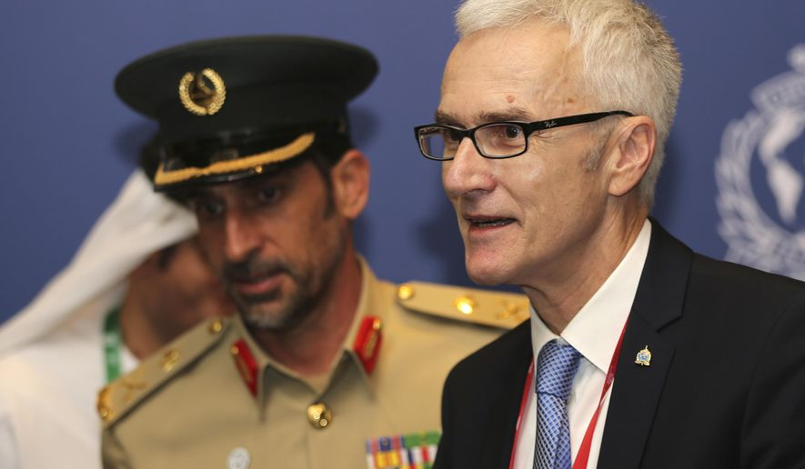Jurgen Stock, Secretary General of Interpol, right, and commander-in-chief of Dubai Police Abdullah Al Marri arrive for a press conference at the opening day of 87th International Criminal Police Organisation (Interpol) General Assembly in Dubai, United Arab Emirates, Sunday, Nov. 18, 2018. (AP Photo/Kamran Jebreili)