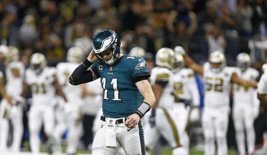 Philadelphia Eagles quarterback Carson Wentz (11) walks off the field after turning the ball over on downs in the second half of an NFL football game against the New Orleans Saints in New Orleans, Sunday, Nov. 18, 2018. (AP Photo/Butch Dill)