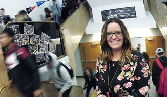 ADVANCE FOR USE MONDAY, NOV. 19, AND THEREAFTER Megan Kraft, a clinical physiologist at The Village in Bismarck, N.D., visits Bismarck High School once a week to help referred students with a range of mental health issues from stress to anxiety and depression. Photo taken on 10-17-2018. (Mike McCleary/The Bismarck Tribune via AP)