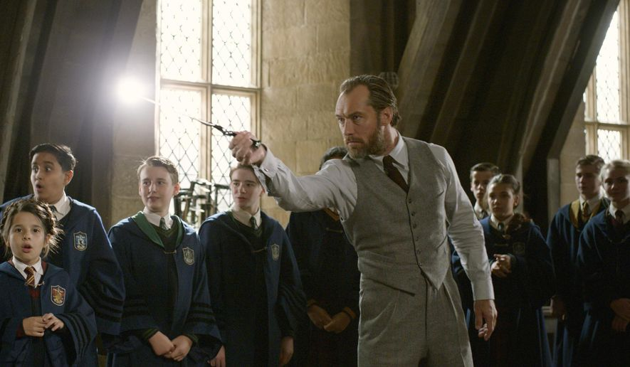 "This image released by Warner Bros. Pictures shows Jude Law in a scene from ""Fantastic Beasts: The Crimes of Grindelwald.""  (Warner Bros. Pictures via AP)"