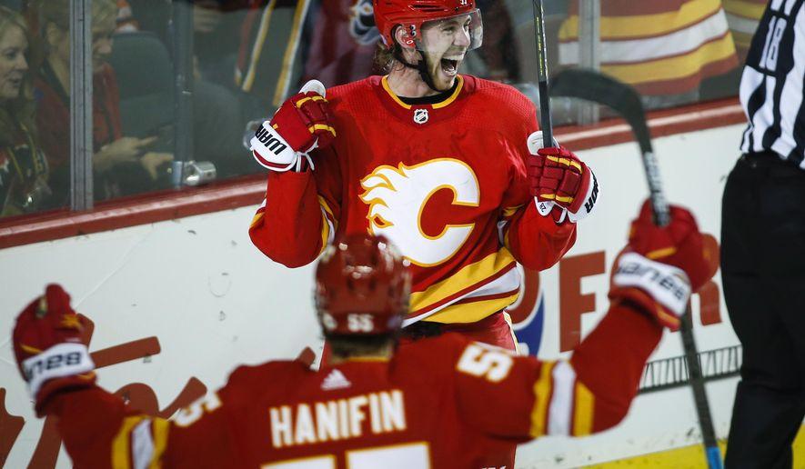 Calgary Flames' Elias Lindholm, of Sweden, celebrates his goal against the Edmonton Oilers during the third period of an NHL hockey game Saturday, Nov. 17, 2018, in Calgary, Alberta. (Jeff Macintosh/The Canadian Press via AP)