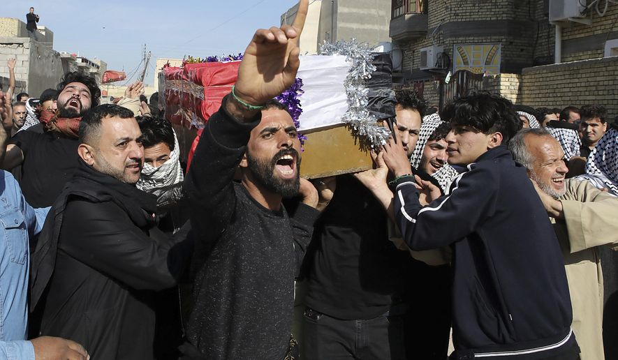 Mourners carry a coffin of prominent social activist Wissam al-Ghrawi in Basra, Iraq, Sunday, Nov. 18, 2018. Iraqi police say religious cleric Wissam, who was linked to the ongoing protests over poor services in Basra, was killed outside his home after suggested that demonstrators should take up arms over the conditions in the city. (AP Photo/Nabil al-Jurani)