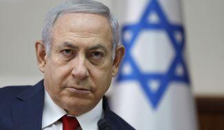 Israeli Prime Minister Benjamin Netanyahu chairs the weekly cabinet meeting at the prime minister's office in Jerusalem, Sunday, Nov. 18, 2018. (Abir Sultan/Pool via AP)