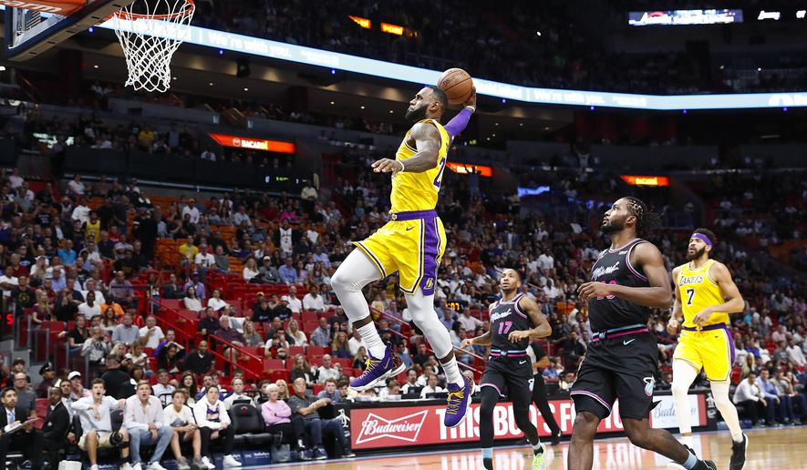 Los Angeles Lakers forward LeBron James scores during the first quarter of an NBA basketball game against the Miami Heat, Sunday, Nov. 18, 2018, in Miami, Fla. (AP Photo/Brynn Anderson)