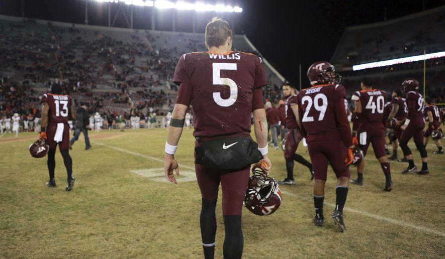 Virginia Tech quarterback Ryan Willis (5) heads to midfield at the conclusion of an NCAA college football game against Miami in Blacksburg, Va., Saturday, Nov. 17 2018. (Matt Gentry/The Roanoke Times via AP)