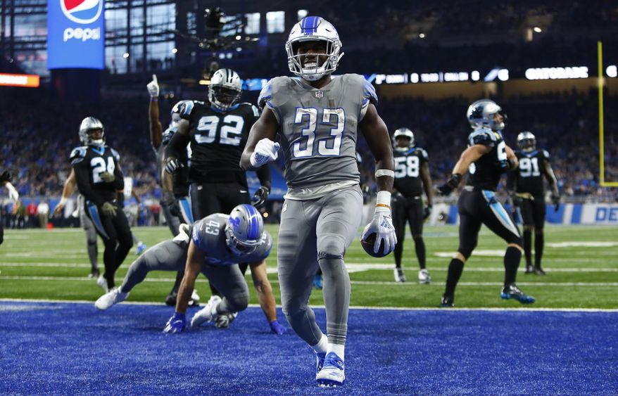 Detroit Lions running back Kerryon Johnson (33) rushes for an 8-yard touchdown during the first half of an NFL football game against the Carolina Panthers, Sunday, Nov. 18, 2018, in Detroit. (AP Photo/Duane Burleson)