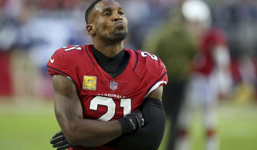 Arizona Cardinals cornerback Patrick Peterson (21) watches during the second half of an NFL football game against the Oakland Raiders, Sunday, Nov. 18, 2018, in Glendale, Ariz. The Raiders won 23-21. (AP Photo/Ross D. Franklin)