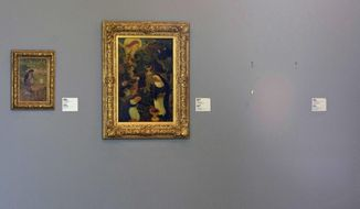 "FILE - In this Tuesday, Oct. 16, 2012 file photo, the empty space where Henri Matisse' painting ""La Liseuse en Blanc et Jaune"" was hanging, right, is seen next to a painting by Maurice Denis, center, and Pierre Bonnard, left, at Kunsthal museum in Rotterdam, Netherlands. Romanian prosecutors are investigating if a painting by Pablo Picasso taken from a museum in the Netherlands six years ago has turned up in Romania it was reported on Sunday, Nov. 18, 2018. Four Romanians were convicted of stealing Picasso's ""Tete d'Arlequin"" and six other valuable paintings from the Kunsthal gallery. (AP Photo/Peter Dejong, File)"