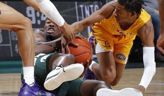 Michigan State's Joshua Langford, left, and Tennessee Tech's Jr. Clay wrestle for the ball during the first half of an NCAA college basketball game Sunday, Nov. 18, 2018, in East Lansing, Mich. (AP Photo/Al Goldis)