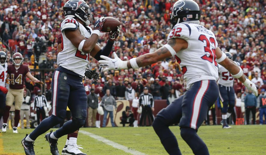 Houston Texans strong safety Justin Reid (20) intercepts a pass and runs 102 yards for a touchdown during the first half of an NFL football game against the Washington Redskins, Sunday, Nov. 18, 2018, in Landover, Md. (AP Photo/Alex Brandon)
