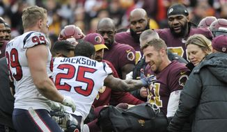 Houston Texans strong safety Kareem Jackson (25) reaches for Washington Redskins quarterback Alex Smith (11) as he leaves the field after an injury during the second half of an NFL football game, Sunday, Nov. 18, 2018 in Landover, Md. (AP Photo/Mark Tenally) **FILE**