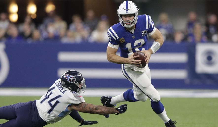 Indianapolis Colts quarterback Andrew Luck (12) runs past Tennessee Titans' Kamalei Correa (44) during the second half of an NFL football game, Sunday, Nov. 18, 2018, in Indianapolis. (AP Photo/Michael Conroy)
