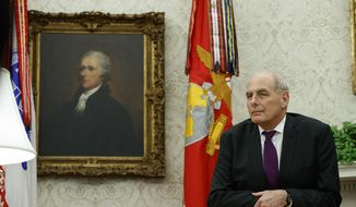 """White House Chief of Staff John Kelly watches as President Donald Trump speaks during a signing ceremony for the """"Cybersecurity and Infrastructure Security Agency Act,"""" in the Oval Office of the White House, Friday, Nov. 16, 2018, in Washington. (AP Photo/Evan Vucci) ** FILE **"""