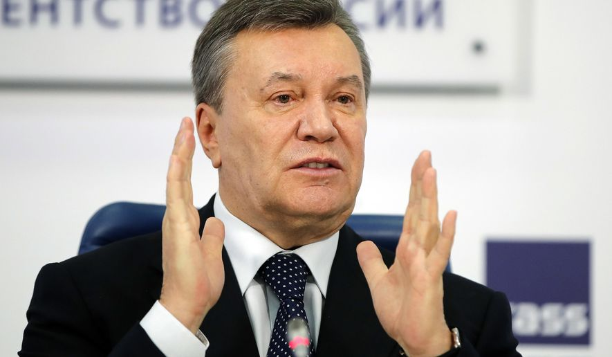 FILE - In this March 2, 2018 file photo, former Ukraine President Viktor Yanukovych gestures as he speaks at a news conference in Moscow. A lawyer representing Yanukovych said on Sunday, Nov. 18, 2018, that his client will be unable to appear before a Kiev court because of injuries sustained on a Moscow tennis court. (AP Photo/Pavel Golovkin, File)