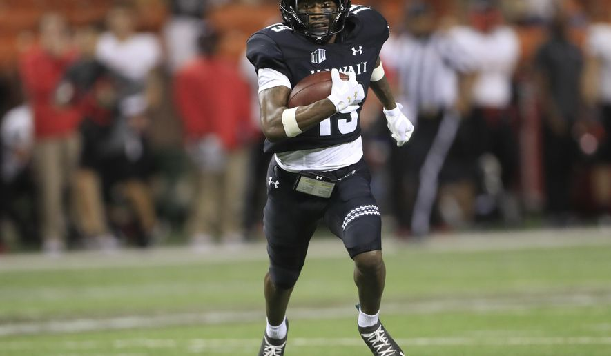 Hawaii wide receiver JoJo Ward (19) runs the ball for a touchdown to tie the game against UNLV during the fourth quarter of an NCAA college football game, Saturday, Nov. 17, 2018, in Honolulu. Hawaii would go on to defeat UNLV 35-28. (AP Photo/Marco Garcia)