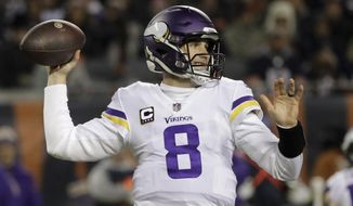 Minnesota Vikings quarterback Kirk Cousins (8) throws a pass during the first half of an NFL football game against the Chicago Bears Sunday, Nov. 18, 2018, in Chicago. (AP Photo/Nam Y. Huh)