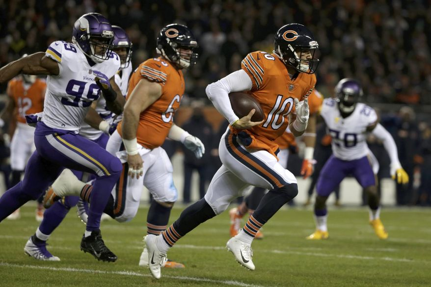 Chicago Bears quarterback Mitchell Trubisky (10) runs during the first half of an NFL football game against the Minnesota Vikings Sunday, Nov. 18, 2018, in Chicago. (AP Photo/David Banks)