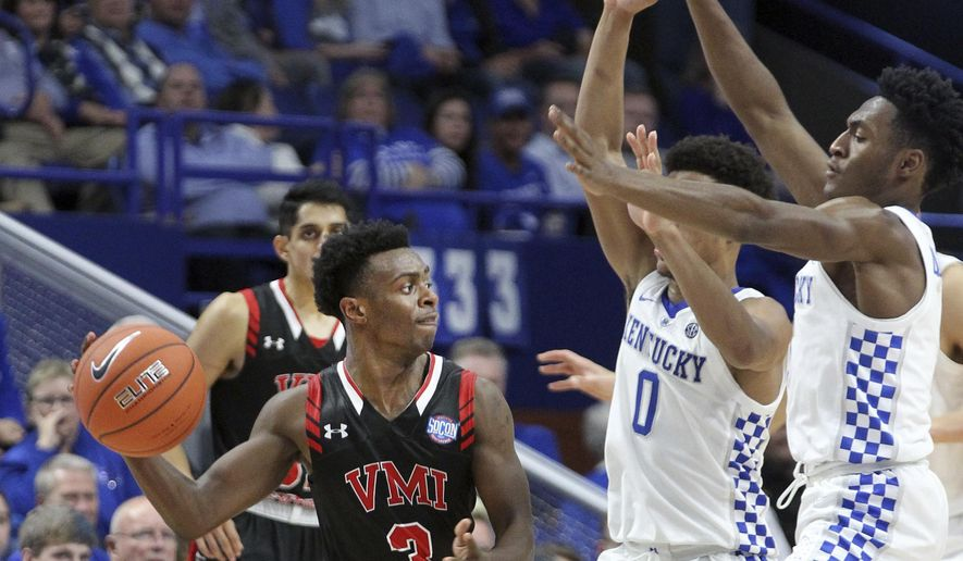 Virginia Military's Bubba Parham (3) passes around Kentucky defenders Quade Green (0) and Immanuel Quickley, right, during the second half of an NCAA college basketball game in Lexington, Ky., Sunday, Nov. 18, 2018. Kentucky won 92-82. (AP Photo/James Crisp)
